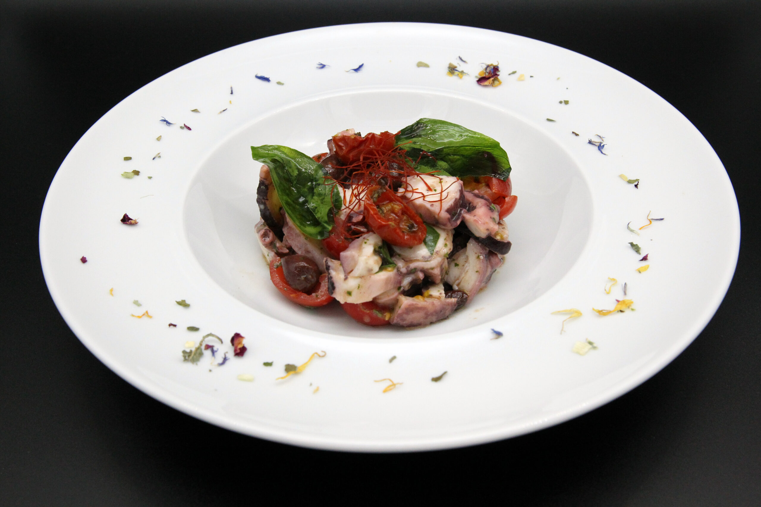 Octopus salad with cherry tomatoes and Taggiasca olives